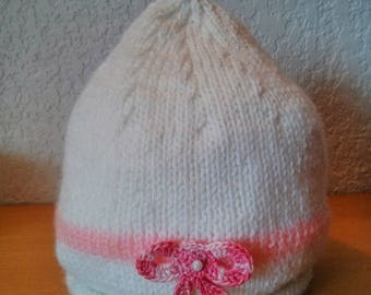 White and pink newborn hat with a bow