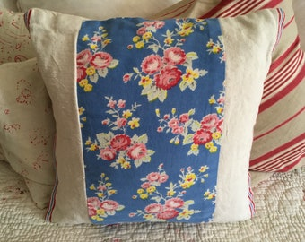 Vintage linen and floral cushion