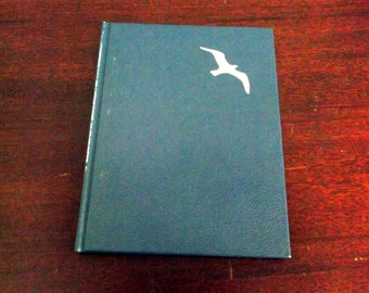 Vintage 1970 book Jonathan Livingston Seafull a Story by Richard Bach photographs by Russell Munson Hardcover