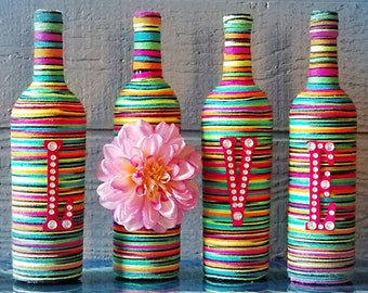 LOVE Upcycled wine bottles with yarn and wood letters