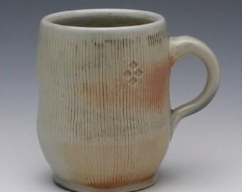 Woodfired, ash glazed porcelain mug with brushed and stamped texture, 12 oz.