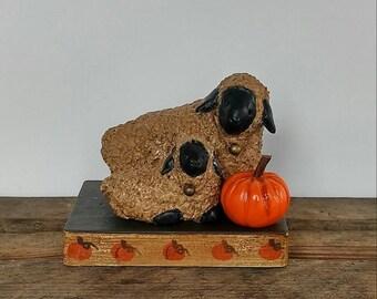 hand sculpted polymer sheep on painted pumpkin base