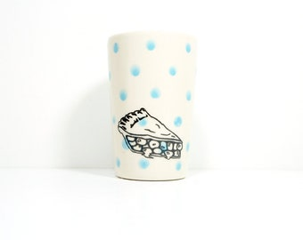 itty bitty cylinder with sky blue polkadots and pie slices, made to order.