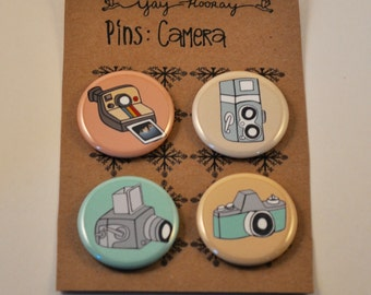 Camera, pin button badges, magnets, film, hand drawn illustrations