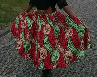 Flared pleated skirt.African print shirt made to order.