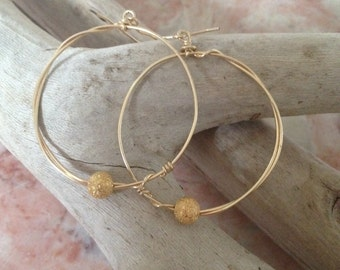 "Gold hoops with stardust ball. Wire wrapped . Hand made 1"" diameter 18c gold filled"