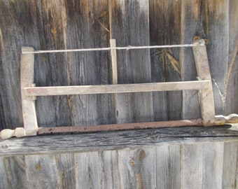 An ancient saw for two people, an ancient saw for cutting trees, an ancient tool of a woodcutter, carpenter, rural decor,