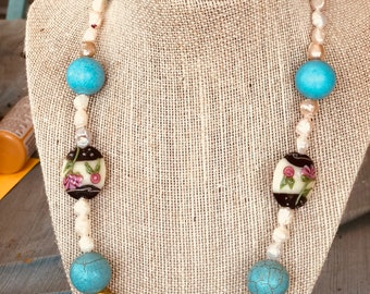 Simply elegant, beaded necklace. Ocean-blue gemstone and lampwork beads.