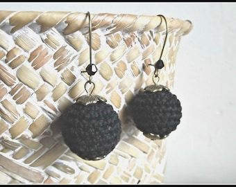 a black crocheted wooden bead earring