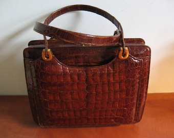 Very nice leather handbag from the 60's ... with copper accents!