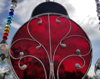 Red Ladybug stained glass suncatcher handmade with wire scrollwork