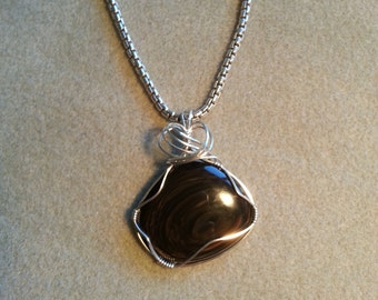 Sterling silver wire wrapped Golden Sheen Obsidian cabochon pendant.