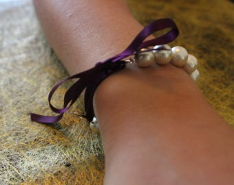 Cotton bow and pearl bracelet