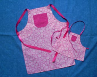 Matching girl and american girl doll aprons.
