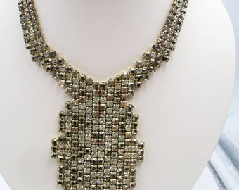 Statement bib or collar necklace with gold and clear rhinestones