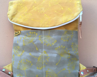 "Yellow canvas backpack, ""overhead"" print"