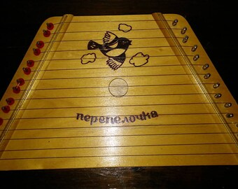 Vintage nepenovka children's harp.  Stamped made in republic of belarus on back.  15 string harp musical instrument