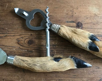 2 bottle openers with metal part and goat legs taxidermy