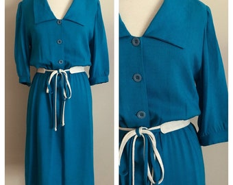 70s Bright Blue Shirtwaist Dress with Pointed Collar and Tassel Belt