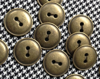 12 vintage metal buttons