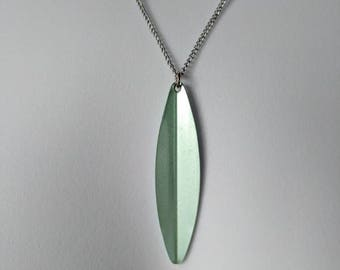 Green Reflective Oval Pendant Necklace on a silver curb chain