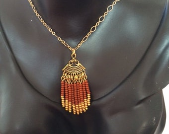 Aged, golden fan pendant necklace