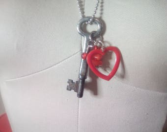 "Vintage key stamped with a 3, embellished with a heart, red beads, hangs on a 24"" ball chain."