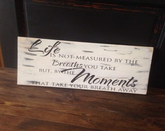 Life is not measured by the breaths we take, inspirational sign