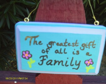The greatest gift is family sign