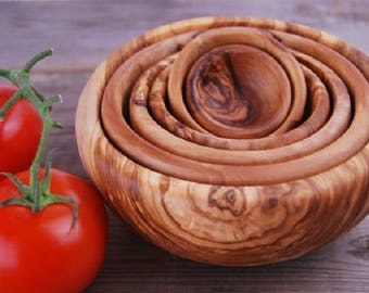 A set of six bowls made with olive wood
