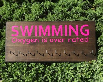 Swimming medal display for swim medals and swimmer ribbons, oxygen is overrated
