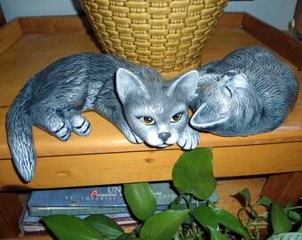 A pair of Ceramic Cats