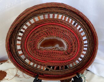 Red weaved pine needle basket