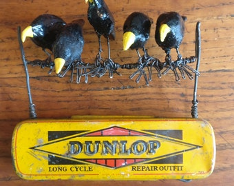 Tin Art - Crows known as The Dunlops, locally, sit and peer down from a telephone wire