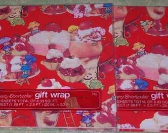 Two retro Strawberry Shortcake American Greetings wrapping paper gift wrap packages