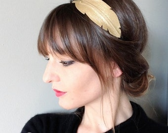 """""""Feather"""" leather mounted on elastic head band"""