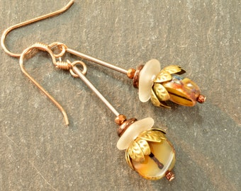 Bronze flower petal dangle earrings with authentic Maine white sea glass and unique caramel Czech glass beads