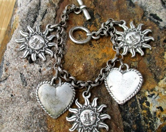 90s distressed silver tone sun and hearts charm bracelet