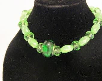 Green glass with charm bracelet