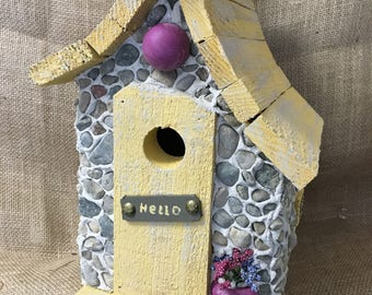 Stone and yellow birdhouse. Colorful and detailed. Outdoor protection.Hanging and easy clean.