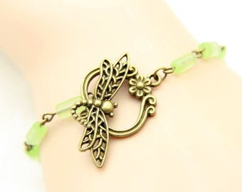 Dragonfly and green glass matte beads Bracelet