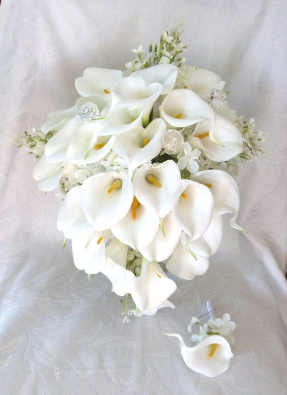 Calla lily lilacs and hydrangea wedding bouquet all white