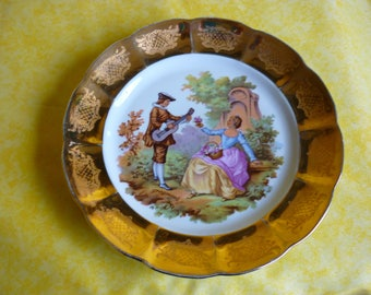 Large plate collection Fragonard in earthenware amourous scene