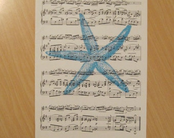 french etoile de mer starfish on shabby chic vintage sheet music