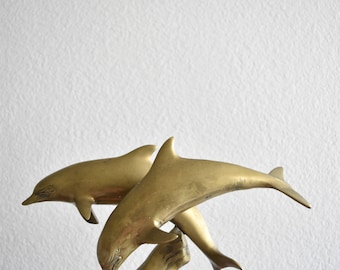 solid brass dolphin figurine / paperweight / nautical
