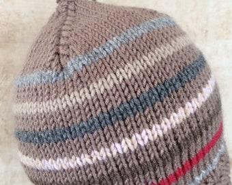 Baby Cashmere Cap accented with Coordinating stripes and Tassel . A luxurious gift for the most special baby.
