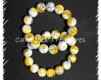 Black,yellow and white stretch bracelet.