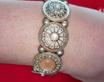 VINTAGE gold coloured metal bracelet with enamelled medallions and glass stones, in a contemporary, victorian style, 1990