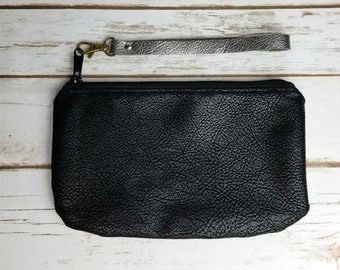 Black faux leather wrist bag with removable strap