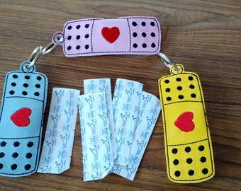 Adhesive Bandage Holder Key Ring....holds 10 regular size bandages